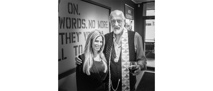 Allison Zucker-Perelman with Mick Fleetwood on art show tour.